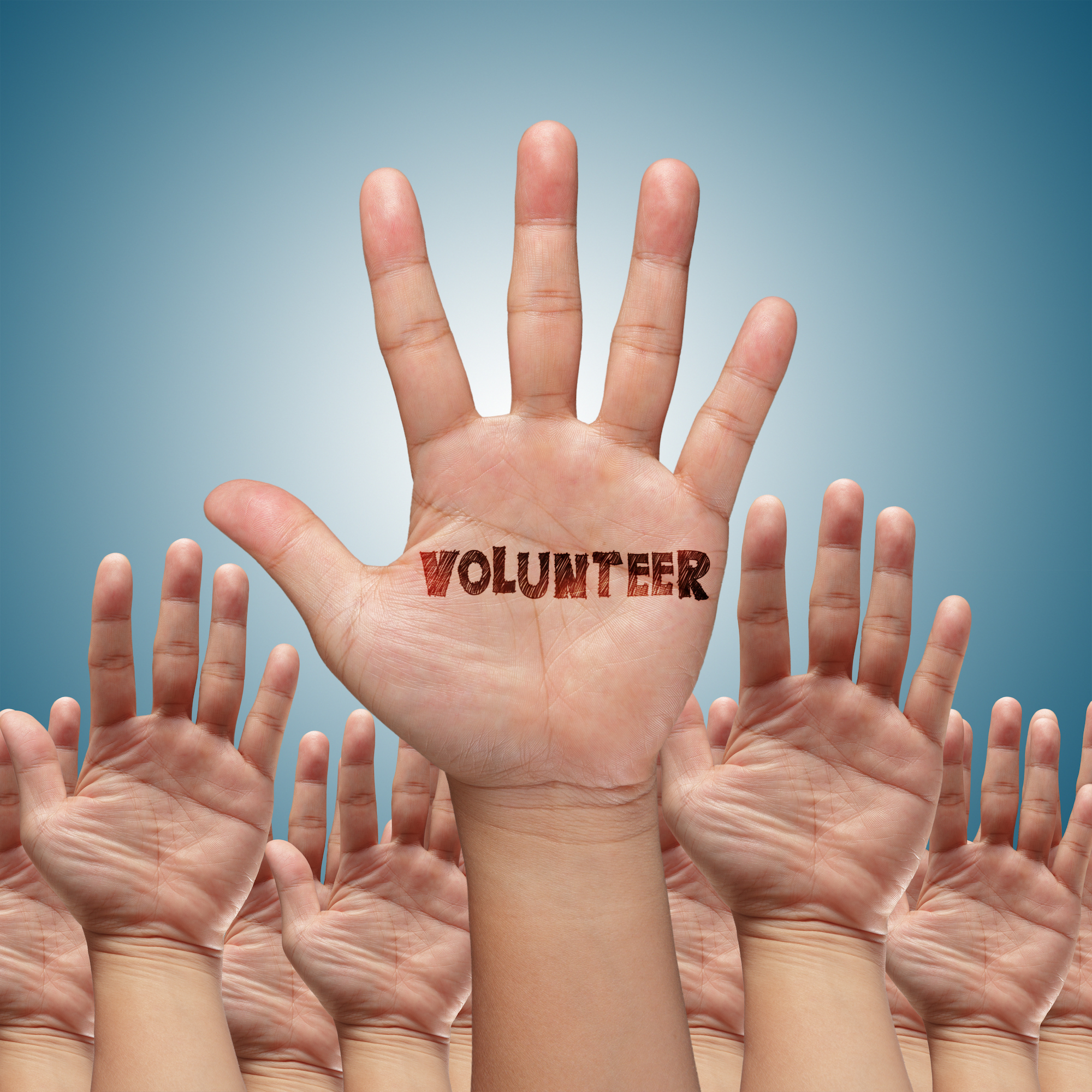 volunteer-group-raising-hands_f1UDr9r_